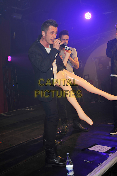 Ritchie Neville and Scott Robinson.Five performing at G-A-Y, Heaven night club, London, England. .20th April 2013.on stage in concert live gig performance music full length black jacket singing side profile blow up doll  .CAP/MAR.© Martin Harris/Capital Pictures.