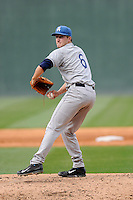 Pitcher Ryan Castellani (6) of the Asheville Tourists delivers a pitch in a game against the Greenville Drive on Friday, April 24, 2015, at Fluor Field at the West End in Greenville, South Carolina. Castellani was a second-round pick of the Colorado Rockies in the 2014 First-Year Player Draft. Greenville won, 5-2. (Tom Priddy/Four Seam Images)