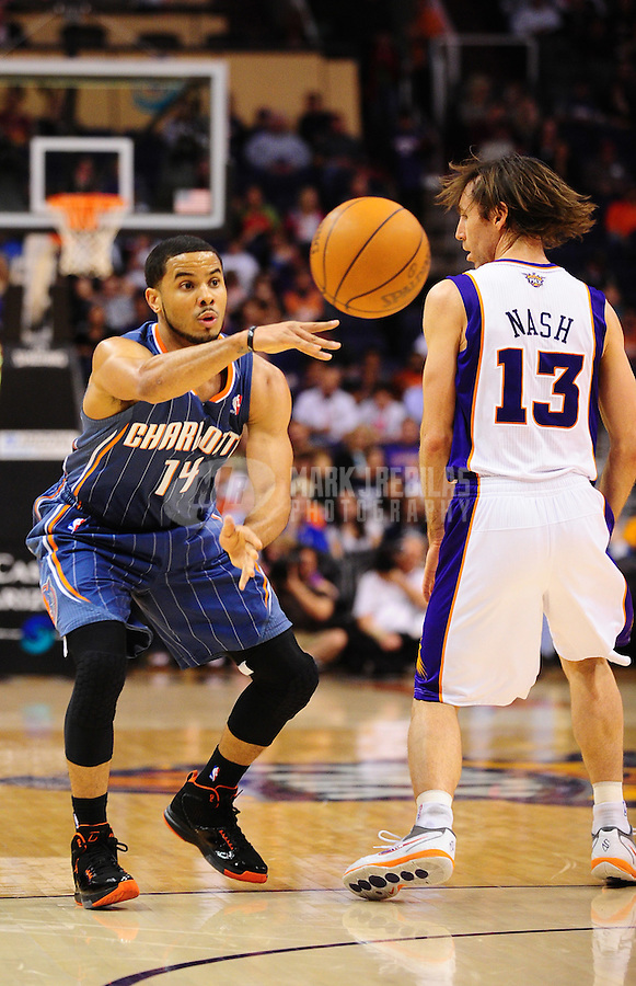 Jan. 26, 2011; Phoenix, AZ, USA; Charlotte Bobcats guard (14) D.J. Augustin against the Phoenix Suns at the US Airways Center. The Bobcats defeated the Suns 114-107. Mandatory Credit: Mark J. Rebilas-