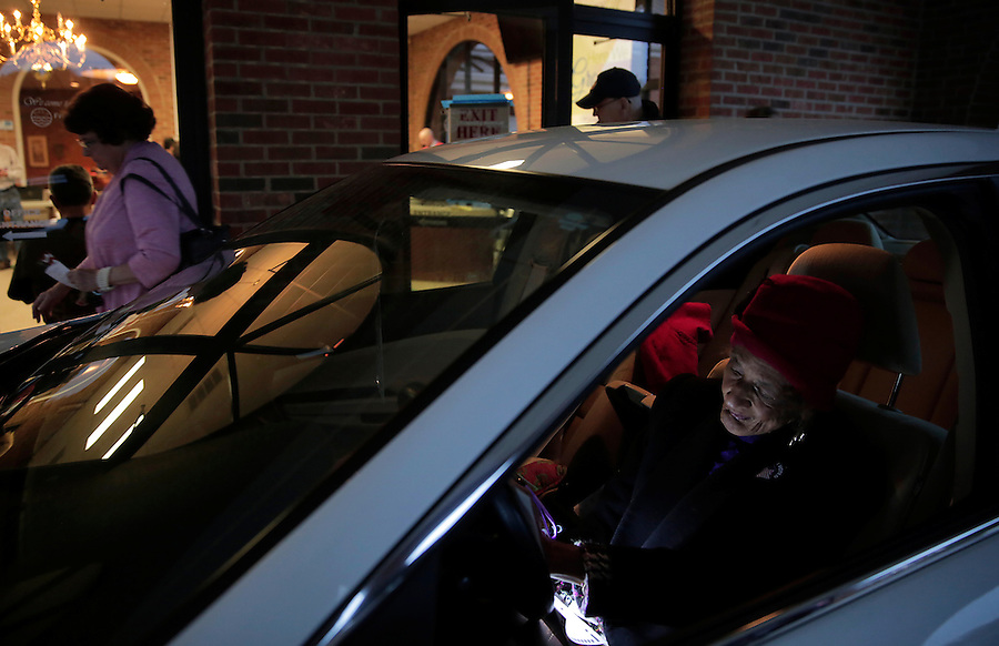 GREENSBORO, NC - NOVEMBER 4:   Helen Knight, lower right, casts a curbside ballot as polls come to a close at Friendly Avenue Church of Christ in Greensboro, NC, on Tuesday, November 4, 2014.  (Photo by Ted Richardson/For The Washington Post)