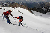 Workers rappel off the side of a slope to attach a blanket to Brunnenkogel Ferner (Austrian word for glacier).  It is being wrapped with a fleece-like cover to keep it from melting. Covered ice melts slower. <br /> The ski area at 3,400 meters is covered to help save the ski industry since the glacier is retreating.  The cost of materials is one Euro per square meter.<br /> <br /> The Alpine glaciers -- in Austria, Switzerland, France and Italy -- are losing one percent of their mass every year and, even supposing no acceleration in that rate, will have all but disappeared by the end of the century. More hot, dry summers like that of 2003 in Europe, when the loss speeded to five percent, could cut the life expectancy to no more than 50 years, according to Wilfried Haeberli of the University of Zurich...&quot;We estimate that by the end of the 21st century, with a medium-type climate scenario, about five percent of what existed in the 1970s will have survived, he added.