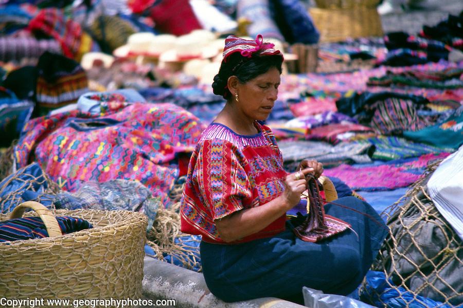 Woman selling textiles, Antigua, Guatemala, Central America,