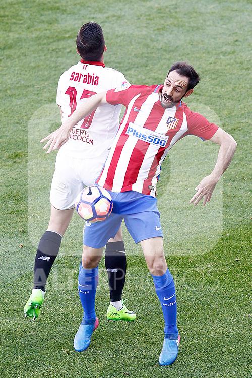 Atletico de Madrid's Juanfran Torres (r) and Sevilla FC's Pablo Sarabia during La Liga match. March 19,2017. (ALTERPHOTOS/Acero)