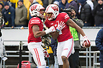 Wisconsin Badgers wide receiver A.J. Taylor (4) celebrates a touchdown reception with teammate Rachid Ibrahim (9) during an NCAA College Big Ten Conference football game against the Michigan Wolverines Saturday, November 18, 2017, in Madison, Wis. The Badgers won 24-10. (Photo by David Stluka)