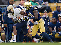 Navy cornerback Brendon Clements (1) intercepts a pass intended for Irish wide receiver DaVaris Daniels (10) in the second quarter.
