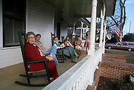 December 1976. Americus, Georgia. People visiting on their front porch in Americus.