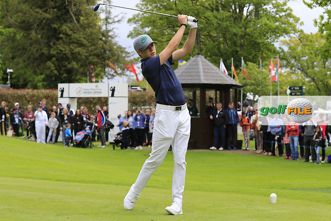 Niall Horan tees off the 1st tee during Wednesday's Pro-Am of the 2016 Dubai Duty Free Irish Open hosted by Rory Foundation held at the K Club, Straffan, Co.Kildare, Ireland. 18th May 2016.<br /> Picture: Eoin Clarke   Golffile<br /> <br /> <br /> All photos usage must carry mandatory copyright credit (&copy; Golffile   Eoin Clarke)