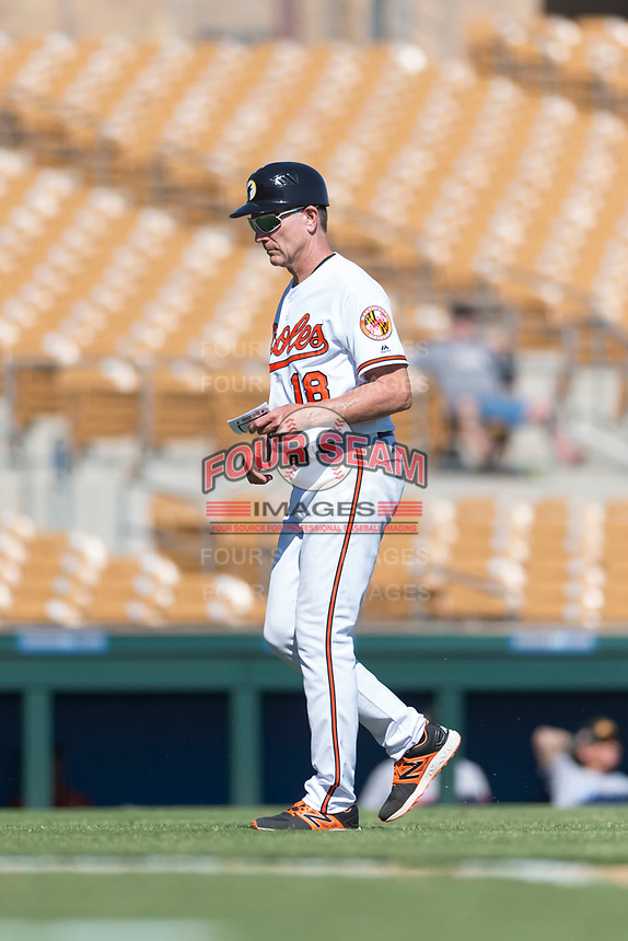 Glendale Desert Dogs manager Dave Anderson (18), of the Baltimore Orioles organization, walks towards the dugout after making a pitching change during an Arizona Fall League game against the Mesa Solar Sox at Camelback Ranch on October 15, 2018 in Glendale, Arizona. Mesa defeated Glendale 8-0. (Zachary Lucy/Four Seam Images)
