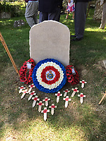 BNPS.,co.uk (01202 558833)<br /> Pic:  JonathanWheeler/BNPS<br /> <br /> Lt Col Strange's gravestone with wreaths after the ceremony at St Nicholas Church at Worth Matravers.<br /> <br /> A war hero who was dubbed the 'bravest man in the world' has been remembered after his lost and abandoned grave was re-discovered.<br /> <br /> The family of Lieutenant Colonel Louis Strange held a moving ceremony in a churchyard after his grave was repaired, spruced-up and re-dedicated. <br /> <br /> Lt Col Strange was a highly-decorated aviator pioneer who served in both world wars and cheated death on two occasions 25 years apart.<br /> <br /> He was buried in a village churchyard in Worth Matravers, Dorset, with a simple gravestone that was found leaning over and covered in lichen.