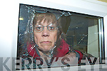Mary Lyne looks through the broken window in Killarney Celtic clubhouse which was attacked by vandals Monday evening