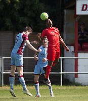 Niran Butler of Flackwell Heath & Shay Lyons (5) of Tuffley Rovers during the UHLSport Hellenic Premier League match between Flackwell Heath v Tuffley Rovers at Wilks Park, Flackwell Heath, England on 20 April 2019. Photo by Andy Rowland.