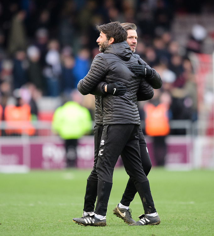 Lincoln City manager Danny Cowley (closest camera) and Lincoln City's assistant manager Nicky Cowley celebrate at the end of the game<br /> <br /> Photographer Chris Vaughan/CameraSport<br /> <br /> The EFL Sky Bet League Two - Lincoln City v Grimsby Town - Saturday 19 January 2019 - Sincil Bank - Lincoln<br /> <br /> World Copyright © 2019 CameraSport. All rights reserved. 43 Linden Ave. Countesthorpe. Leicester. England. LE8 5PG - Tel: +44 (0) 116 277 4147 - admin@camerasport.com - www.camerasport.com