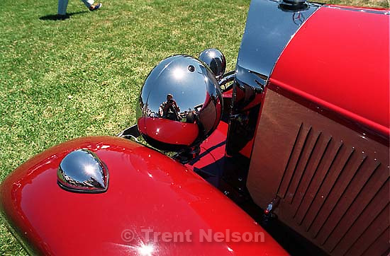 Trent Nelson with camera reflected at concours car show<br />