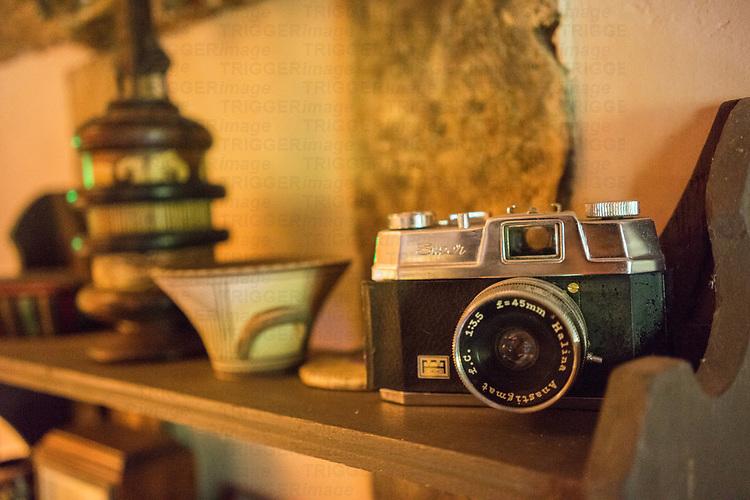 Vintage camera on shelf in old cottage in England