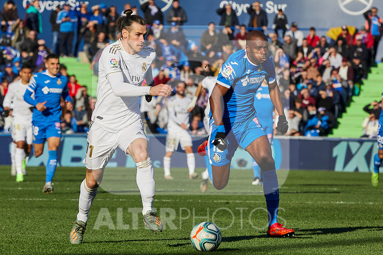Gareth Bale of Real Madrid and Allan-Romeo Nyom of Getafe FC during La Liga match between Getafe CF and Real Madrid at Coliseum Alfonso Perez in Getafe, Spain. January 04, 2020. (ALTERPHOTOS/A. Perez Meca)