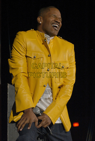 JAMIE FOXX.Oscar winner Jamie Foxx performs at the Norfolk Scope, Norfolk, Virginia, USA, 22 March 2007..half length concert gig funny face yellow leather jacket.CAP/ADM/MK.©Mike Klein/AdMedia/Capital Pictures.