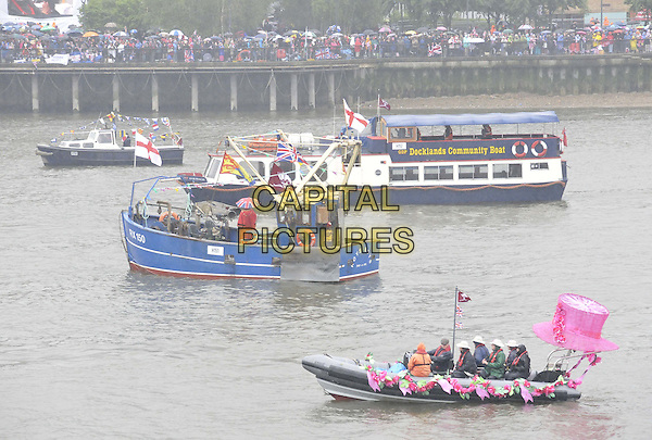 some of the boats.sailing as part of the Diamond Jubilee River Pageant, River Thames, London, England..June 3rd, 2012.gv general view water river flags crowd pink hat  .CAP/CAN.©Can Nguyen/Capital Pictures.