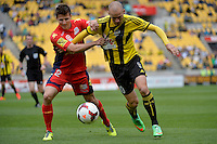 Stein Hutsegems and Michael Marrone during the A League - Wellington Phoenix v Adelaide United, Wellington, New Zealand on Sunday 30 March 2014. <br /> Photo by Masanori Udagawa. <br /> www.photowellington.photoshelter.com.