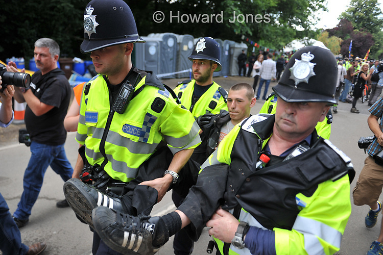 Anti fracking demonstrator being arrested after a sit in direct action against gas exploration company Cuadrilla in Balcombe. The company has temporarily suspended drilling due to safety concerns. 19th Aug 3012