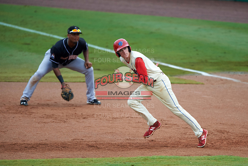 Clearwater Threshers outfielder Carlos Tocci (19) running the bases in front of first baseman Felix Munoz (24) during the first game of a doubleheader against the Jupiter Hammerheads on July 25, 2015 at Bright House Field in Clearwater, Florida.  Jupiter defeated Clearwater 8-5.  (Mike Janes/Four Seam Images)