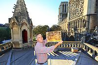"""Nicolas Géant on the roof of the bishop's palace of the cathedral Notre Dame of Paris. """"I have realized a childhood dream: have bees at Notre Dame. When you think about the importance of bees for the Catholic Church throughout history, the importance of wax for candles to light the church, for me it's full of meaning... The symbolism of the bees and their honey in the Catholic bestiary is powerful. They represent the unputrefiable body of Jesus Christ combined with the purity of virginity.///Paris / Nicolas Géant sur le toit de l'évèché de Notre Dame de Paris. «J'ai réalisé un rève d'enfant, avoir des abeilles à Notre Dame. Quand l'on sait l'importance des abeilles pour l'église catholique à travers l'histoire, l'importance de la cire pour éclairé les églises, c'est pour moi pleins de sens… La symbolique des abeilles et leur miel dans le bestiaire catholique est puissant. Elles représentent le corps imputrésible de Jesus Christ allié à la pureté de la virginité."""