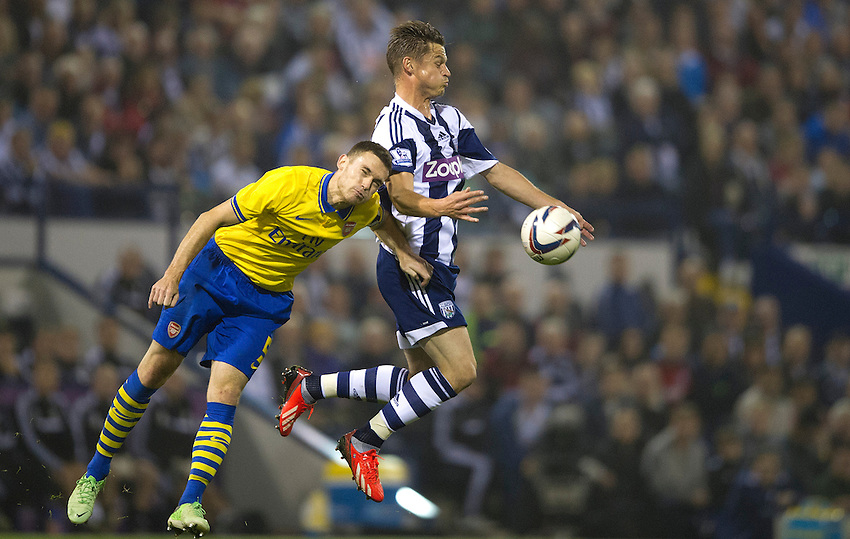 West Bromwich Albion's Markus Rosenberg and Arsenal's Thomas Vermaelen<br /> <br /> Photo by Stephen White/CameraSport<br /> <br /> Football - Capital One Cup Third Round - West Bromwich Albion v Arsenal - Wednesday 25th September 2013 - The Hawthorns - West Bromwich<br />  <br /> &copy; CameraSport - 43 Linden Ave. Countesthorpe. Leicester. England. LE8 5PG - Tel: +44 (0) 116 277 4147 - admin@camerasport.com - www.camerasport.com