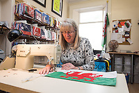 STORY BY STEVEN MORRIS SWANSEA, UK. 5th July 2015. Kath Kearney from mrflag.com making a sewn Welsh flag.