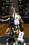 SIOUX FALLS, SD - MARCH 12:  Bryce Lienhoop #23 from St. Francis jumps the opening tip against Aziz Leeks #22 from the College of Idaho during their semifinal game at the 2018 NAIA DII Men's Basketball Championship at the Sanford Pentagon in Sioux Falls. (Photo by Dave Eggen/Inertia)