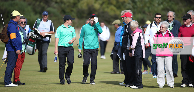 Jack Hume (IRL) and /gm divide the crowd on the 13th fairway during Sunday morning Foursome matches of The Walker Cup 2015 played at Royal Lytham and St Anne's, Lytham St Anne's, Lancashire, England. 13/09/2015. Picture: Golffile | David Lloyd<br /> <br /> All photos usage must carry mandatory copyright credit (&copy; Golffile | David Lloyd)