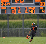 Wesclin kicker Christian Gonzalez kicks off after a fourth quarter Wesclin touchdown that put them ahead of Dupo. Wesclin defeated Dupo 34-30 on Saturday August 31, 2019 in a game that was stopped Friday night at halftime due to storms. <br /> Tim Vizer/Special to STLhighschoolsports.com