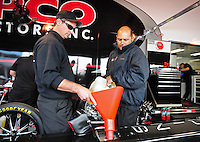 Feb. 17 2012; Chandler, AZ, USA; Crew members prepare the top fuel dragster driven by Steve Torrence during the NHRA Arizona Nationals at Firebird International Raceway. Mandatory Credit: Mark J. Rebilas-