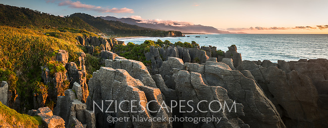 Sunset on rock formations at Dolomite Point in Punakaiki, Paparoa National Park, Buller Region, West Coast, New Zealand, NZ