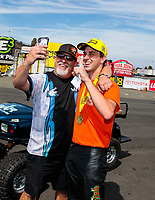 Jul 29, 2018; Sonoma, CA, USA; NHRA pro stock motorcycle rider L.E. Tonglet celebrates with crew member after winning the Sonoma Nationals at Sonoma Raceway. Mandatory Credit: Mark J. Rebilas-USA TODAY Sports