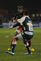 Maro Itoje of Saracens in action against Telusa Veainu of Leicester Tigers during the Premiership Rugby match between Saracens and Leicester Tigers - 02/01/2016 - Allianz Park, London<br /> Mandatory Credit: Rob Munro/Stewart Communications