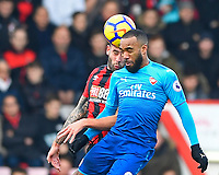 Steve Cook of AFC Bournemouth and Alexandre Lacazette of Arsenal vie for a header during AFC Bournemouth vs Arsenal, Premier League Football at the Vitality Stadium on 14th January 2018