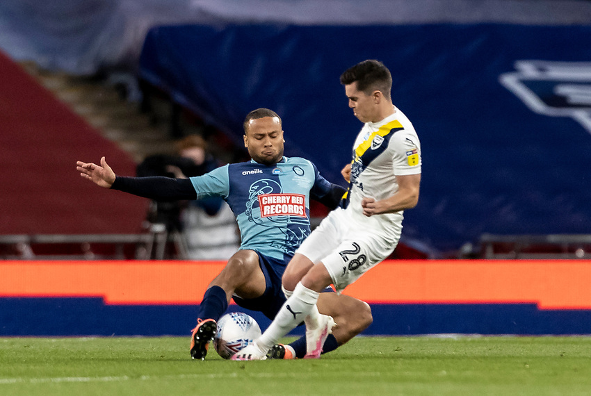 Wycombe Wanderers' Curtis Thompson (left) fouls Oxford United's Liam Kelly <br /> <br /> Photographer Andrew Kearns/CameraSport<br /> <br /> Sky Bet League One Play Off Final - Oxford United v Wycombe Wanderers - Monday July 13th 2020 - Wembley Stadium - London<br /> <br /> World Copyright © 2020 CameraSport. All rights reserved. 43 Linden Ave. Countesthorpe. Leicester. England. LE8 5PG - Tel: +44 (0) 116 277 4147 - admin@camerasport.com - www.camerasport.com