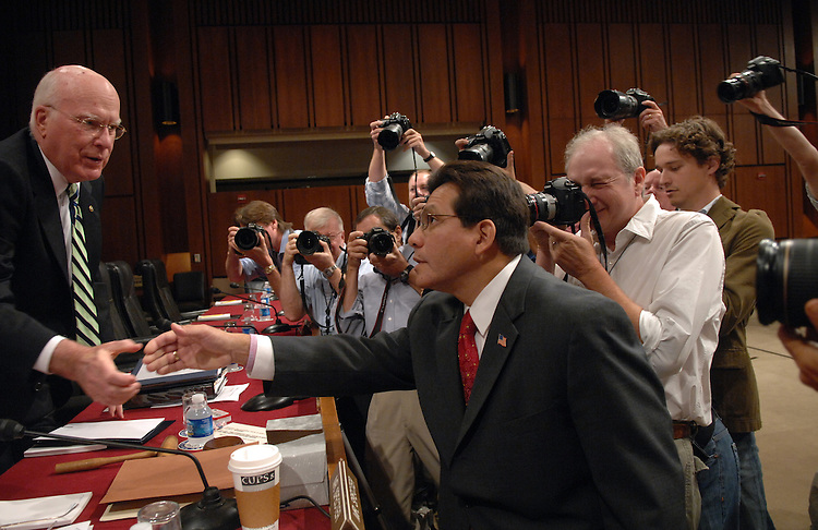 Attorney General Alberto Gonzales greets Senators including Chairman Pat Leahy, D-Vt., before a Senate Judiciary Committee hearing on oversight of the Department of Justice.