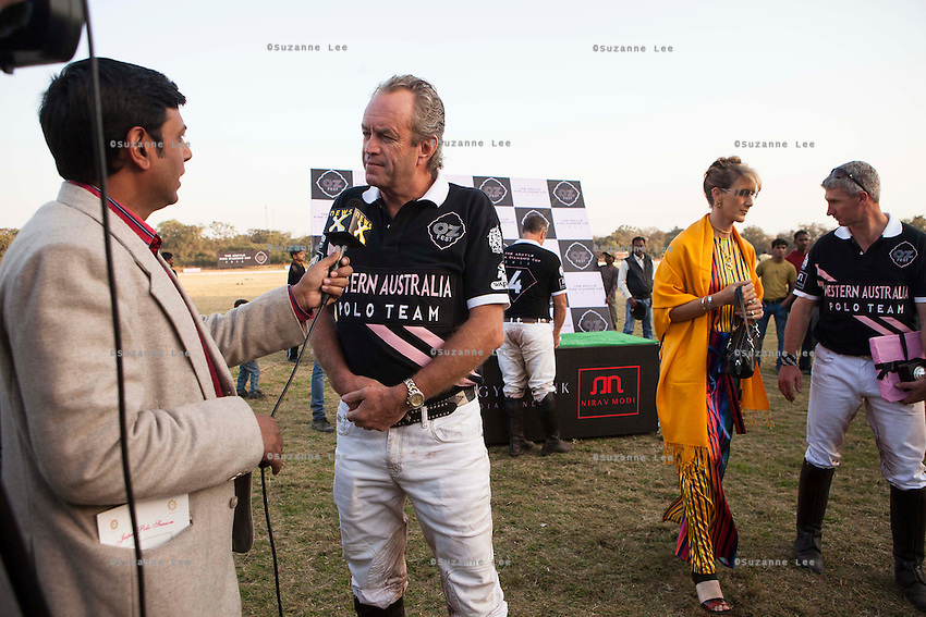 Western Australia Polo Team captain Greg Johnson (center) gives an interview to a local channel after the Argyle Pink Diamond Cup, organised as part of the 2013 Oz Fest in the Rajasthan Polo Club grounds in Jaipur, Rajasthan, India on 10th January 2013. Photo by Suzanne Lee