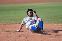 Scottsdale Scorpions left fielder Kevin Kaczmarski (17), of the New York Mets organization, slides safely across home plate during a game against the Peoria Javelinas on October 19, 2017 at Peoria Stadium in Peoria, Arizona. The Scorpions defeated the Javelinas 13-7.  (Zachary Lucy/Four Seam Images)