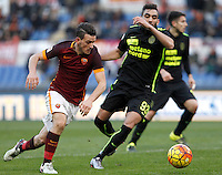 Calcio, Serie A: Roma vs Hellas Verona. Roma, stadio Olimpico, 17 gennaio 2016.<br /> Roma&rsquo;s Alessandro Florenzi, left, is challenged by Hellas Verona&rsquo;s Mohamed Fares during the Italian Serie A football match between Roma and Hellas Verona at Rome's Olympic stadium, 17 January 2016.<br /> UPDATE IMAGES PRESS/Isabella Bonotto