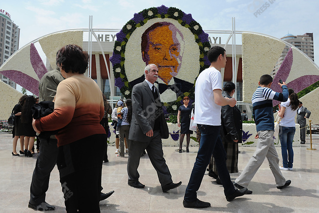 In Baku people walked past a huge portrait of the former Azeri leader Haidar Aliyev created with flower blooms to celebrate the the former president's birthday.  The anniversary celebration was combined with a annual flower festival. Baku, Azerbaijan, May 12, 2011