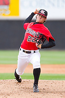 Relief pitcher Cody Buckel #22 of the Hickory Crawdads in action against the Greensboro Grasshoppers at L.P. Frans Stadium on May 18, 2011 in Hickory, North Carolina.   Photo by Brian Westerholt / Four Seam Images