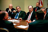 United States President George W. Bush participates in a homeland security briefing with U.S. Vice President Dick Cheney, left, and newly-appointed Homeland Security Advisor General John Gordon, center, in the Roosevelt Room at the White House in Washington, DC, April 29, 2003.<br /> Mandatory Credit: Eric Draper / White House via CNP