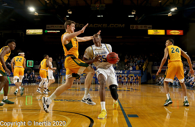 BROOKINGS, SD - JANUARY 22: Douglas Wilson #35 of the South Dakota State Jackrabbits drives to the basket against Rocky Kreuser #34 of the North Dakota State Bison at Frost Arena on January 22, 2020 in Brookings, South Dakota. (Photo by Dave Eggen/Inertia)