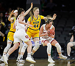 SIOUX FALLS, SD - MARCH 8: Madison Nelson #23 of the Denver Pioneers pivots and drives to the basket against Danneka Voegeli #44 of the North Dakota State Bison at the 2020 Summit League Basketball Championship in Sioux Falls, SD. (Photo by Richard Carlson/Inertia)
