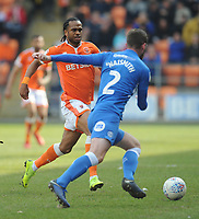 Peterborough United's Jason Naismith under pressure from Blackpool's Nathan Delfouneso<br /> <br /> Photographer Kevin Barnes/CameraSport<br /> <br /> The EFL Sky Bet League One - Blackpool v Peterborough United - Saturday 13th April 2019 - Bloomfield Road - Blackpool<br /> <br /> World Copyright &copy; 2019 CameraSport. All rights reserved. 43 Linden Ave. Countesthorpe. Leicester. England. LE8 5PG - Tel: +44 (0) 116 277 4147 - admin@camerasport.com - www.camerasport.com