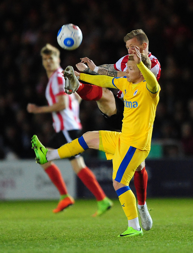 Lincoln City's Alan Power vies for possession with Chester's Elliott Durrell<br /> <br /> Photographer Chris Vaughan/CameraSport<br /> <br /> Vanarama National League - Lincoln City v Chester - Tuesday 11th April 2017 - Sincil Bank - Lincoln<br /> <br /> World Copyright &copy; 2017 CameraSport. All rights reserved. 43 Linden Ave. Countesthorpe. Leicester. England. LE8 5PG - Tel: +44 (0) 116 277 4147 - admin@camerasport.com - www.camerasport.com