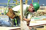 Market Street Bridge construction, Williamsport, PA. Worker with hammer.