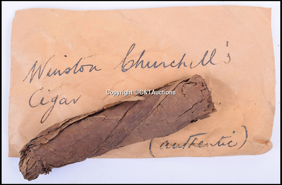 """BNPS.co.uk (01202 558833)Pic: C&TAuctions/BNPS<br /> <br /> Winston Churchill's half-smoked cigar that was taken from an ashtray at 10 Downing Street by a civil servant has come to light.<br /> <br /> Part of his trademark look, the cigar was smoked on Churchill's last day in office as Prime Minister in 1955.<br /> <br /> George Henry Townsend, who served under Churchill, picked it up as a souvenir.<br /> <br /> He later placed the two inch long stub in a small envelope for safekeeping. He wrote on the envelope: """"Winston Churchill's cigar (authentic).""""<br /> <br /> While the finished cigar would usually be cast aside as rubbish this one carries a value of about £300."""