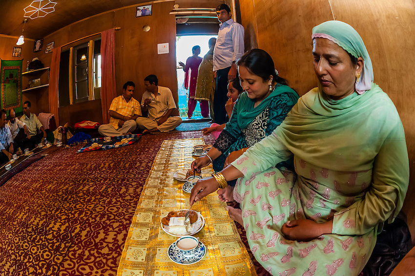 A Muslim engagement party where the bride and grooms families meet, in a houseboat on Dal Lake, Srinagar, Kashmir, Jammu and Kashmir State; India.